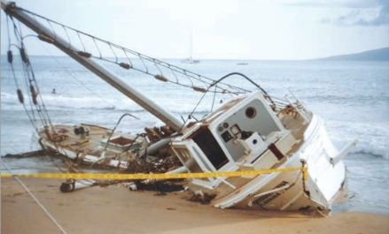 This boat was destroyed and beached in front of the Sheraton at Black Rock at Ka'anapali Beach, Maui, by Hurricane Iniki in 1992. Photo courtesy of Ward Graessle.