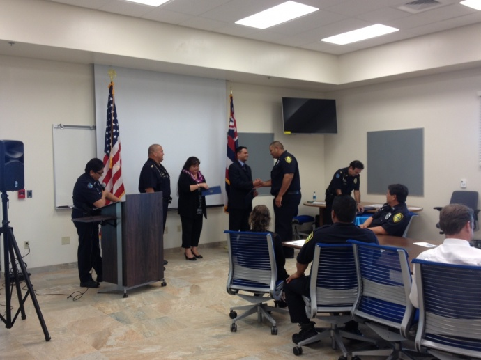 Molokai officer, Nathaniel Hubbard receives a certificate from Dr. Rampersad during the 4th CIT graduation. Sept. 29, 2014.