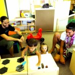 Dad's watch as their keiki explore the new Hāna Infant and Toddler Center. Courtesy photo.