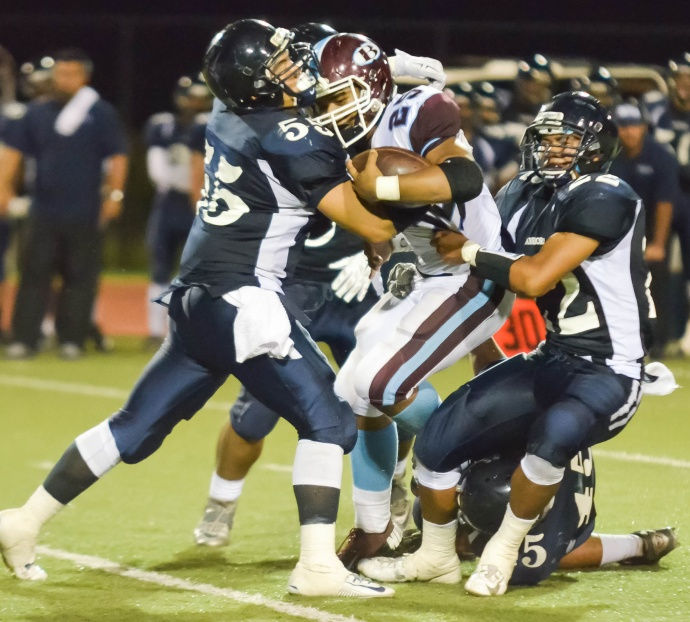 Kamehameha Maui's Brennon Aloy and Ikaika Chong Kee wrap up Baldwin running back Keanan Luis during first-half action Friday. Photo by Rodney S. Yap.