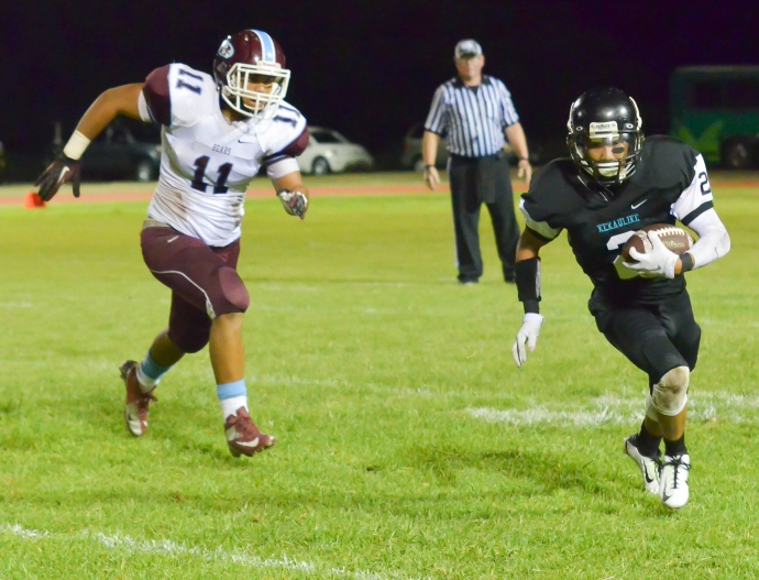 Baldwin's Nohea Keahi (11) chases down King Kekaulike's Micah Taberna (2) during second-half action Friday  Upcountry. Photo by Rodney S. Yap.