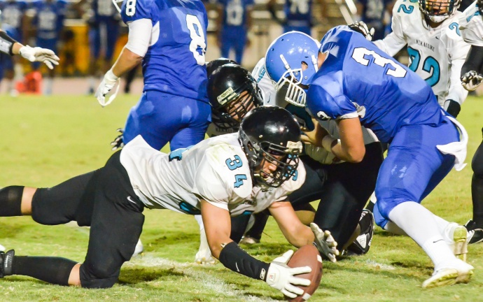 King Kekaulike's Kanoa Awai-Dickson (34) jumps on this fumble against Maui High Saturday at War Memorial Stadium. Photo by Rodney S. Yap.
