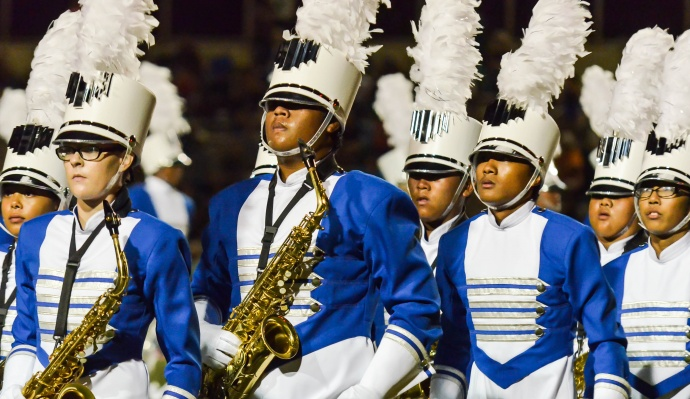 Members of the Maui High School Marching Band & Color Guard exit the field after halftime Saturday at War Memorial Stadium. Photo by Rodney S. Yap.