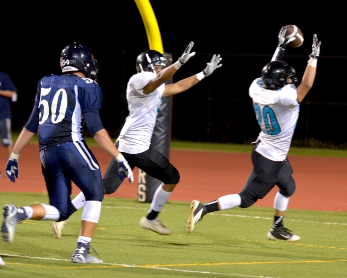 King Kekaulike's Drevyn Tavares turns a fumble into a 6-yard touchdown run during third-quarter action Friday. Photo by Rodney S. Yap.