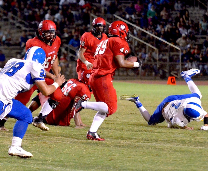 Lahainaluna's Ryan Delatori (49) takes it to the house in the fourth quarter Saturday. His 50-yard interception for touchdown helped the Lunas beat Maui High 14-0 Saturday. Photo by Rodney S. Yap.