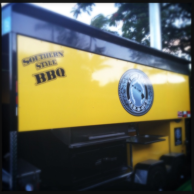 Formerly a food truck, two large yellow smokers are parked outside. Photo by Vanessa Wolf