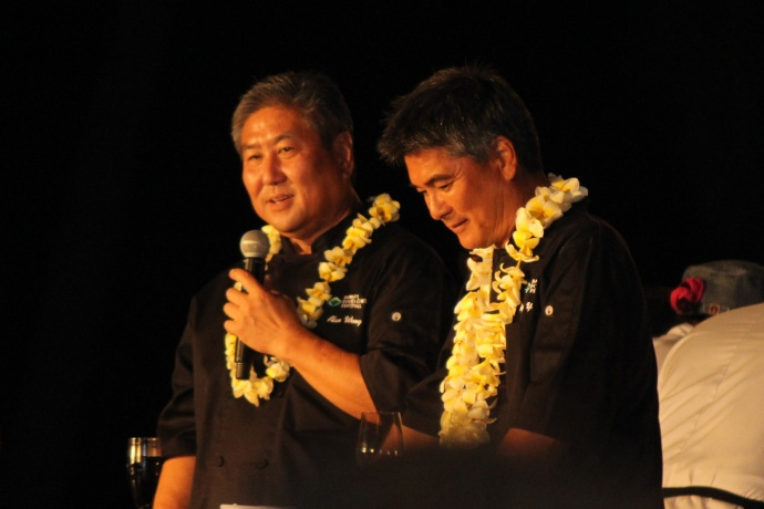 Chef Alan Wong (left) and Chef Roy Yamaguchi (right) at Kāʻanapali Kitchen Stadium. Photo by Wendy Osher.