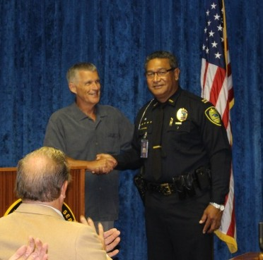 Police Commission Chair Roger Dixon congratulates Tivoli Faaumu, who was selected the new Maui Police Chief. Photo by Wendy Osher.
