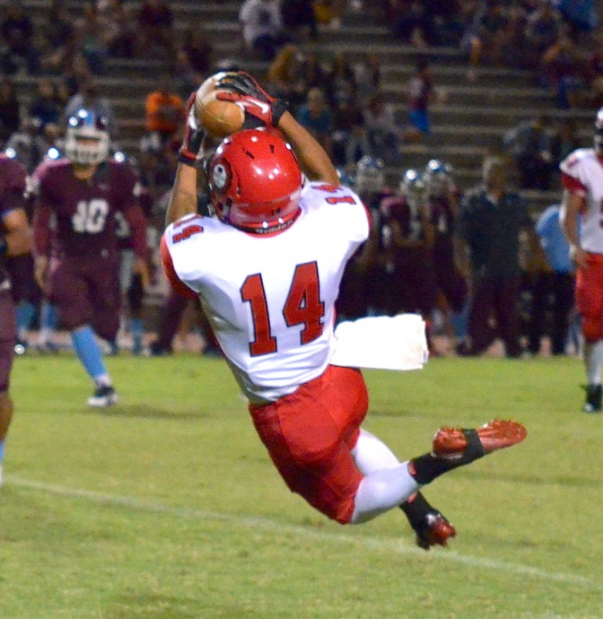 Lahainaluna's Josten Saribay hung on to this pass despite going airborne. Photo by Rodney S. Yap.
