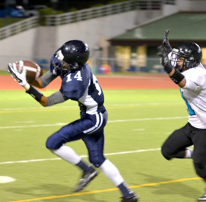 Kamehameha Maui's Keoni Keanini makes this over the shoulder catch in the fourth quarter Friday against King Kekaulike. Photo by Rodney S. Yap.