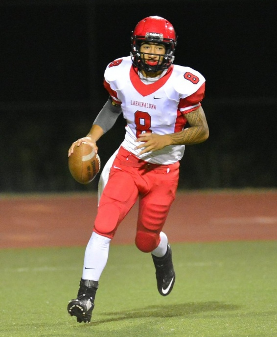 Lahainaluna's Makoa Filikitonga (8) threw for three touchdowns and ran for another Saturday against Kamehameha Maui.  Photo by Glen Pascual.