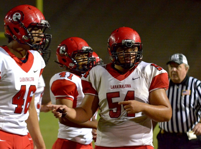 Lahainaluna's Connor Mowat (54) communicates with his coaches on the sidelines Saturdaty. Photo by Rodney S. Yap.