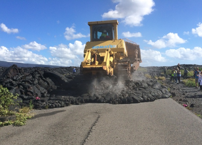 "Work began today in Hawaiʻi Volcanoes National Park on the emergency access route between the park and lower Puna on the historic Chain of Craters Road-Kalapana road alignment. Park staff removed the iconic ""Road Closed"" sign before the first bulldozer rolled onto the lava-covered roadway. Photo courtesy of the National Park Service."