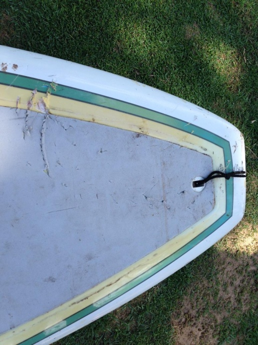 Shark bite impressions on paddle board from today's (10/22/14) encounter in South Maui. Photo courtesy DLNR.