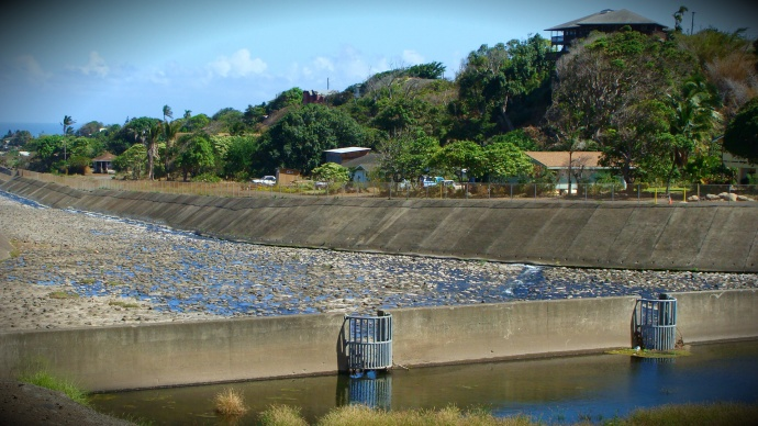 In order for continuous flow downstream, water must get past a diversion near Happy Valley operated by Hawaiian Commercial and Sugar Company. File photo by Wendy Osher.