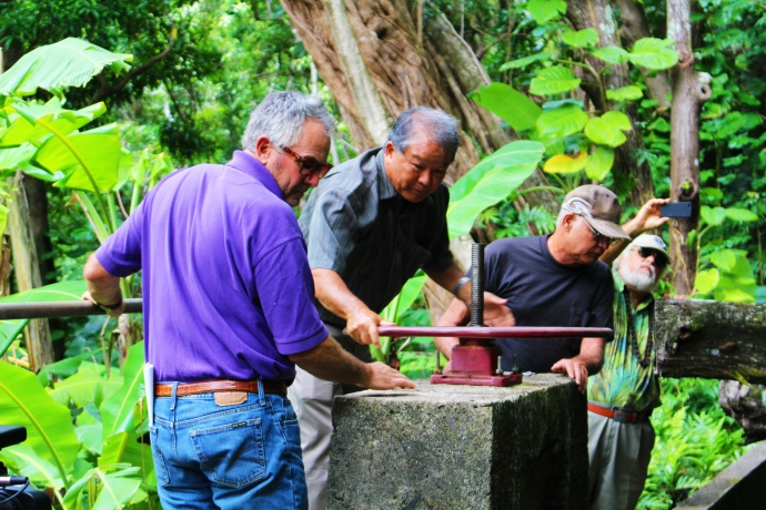 Wailuku Water Company president Avery Chumbley (left with purple shirt) oversees the release of 10 mgd of water above Kepaniwai.  The release was part of an agreement reached with several environmental groups including Hui O Nā Wai ʻEhā and Earthjustice.  Photo by Wendy Osher.