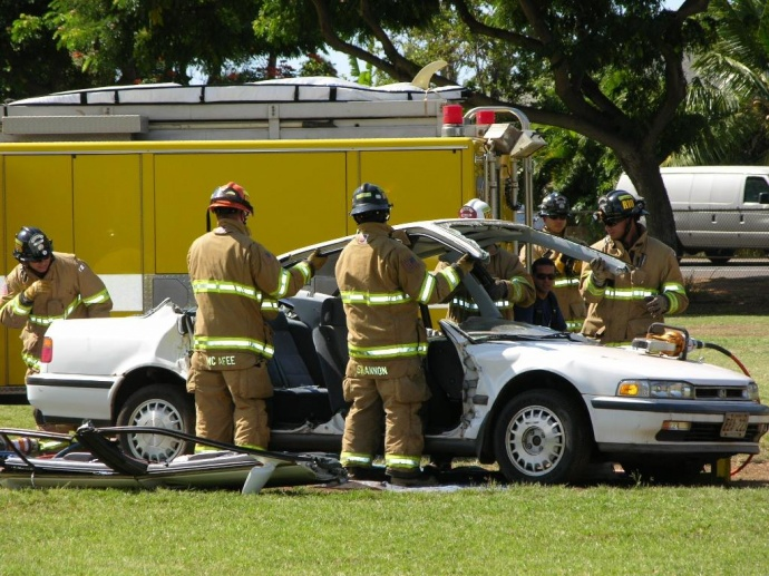 Maui fire fighters demonstrate how they remove a car rooftop to extract crash victims. Photo courtesy County of Maui.