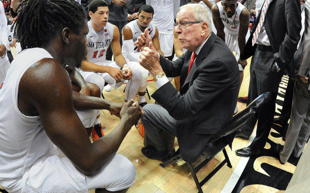San Diego State University head coach Steve Fisher talks to his team during a timeout of a recent game. Photo courtesy of Aztecs Athletics.