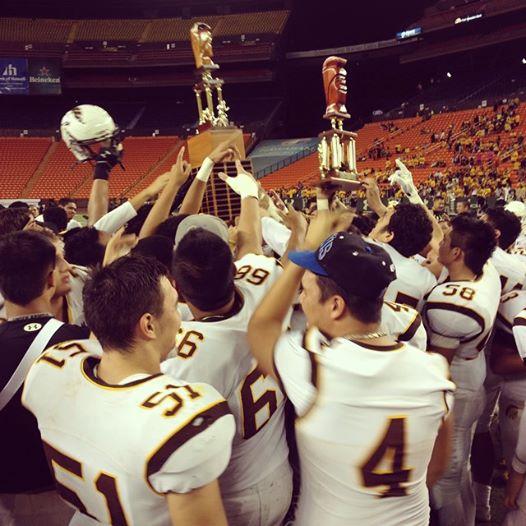 The Mililani High School football team celebrates its Division I state championship Friday at Aloha Stadium. Photo courtesy of OC16.