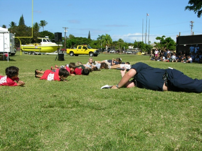 Fire fighters teach kids how to stop, drop and roll. Photo courtesy County of Maui.