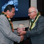 Woodbury President Dr. Luis Maria R. Calingo presents Speaker Joseph M. Souki with the Distinguished Alumni Award. Courtesy photo.