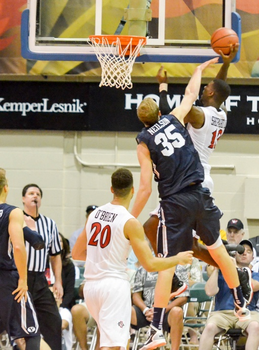 Winston Shepard goes up for a basket against BYU's Isaac Neilson (35) during second-half action Monday at the Maui Invitational Tournament at Lahaina Civic Center. Photo by Rodney S. Yap.