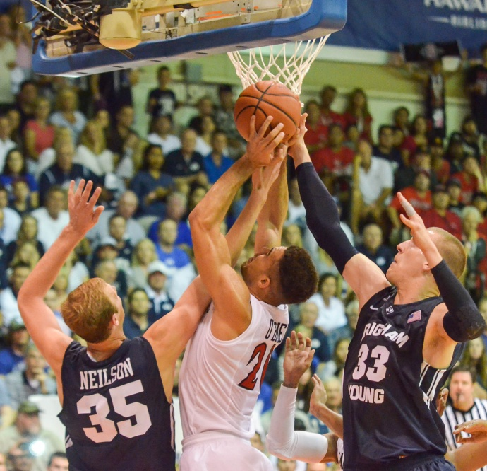 San Diego State's J.J. O'Brien goes up for a rebound against BYU's Nate Austin (33) and Isaac Neilson (35) during first-round action Monday of the Maui Invitational Tournament at Lahaina Civic Center. Photo by Rodney S. Yap.