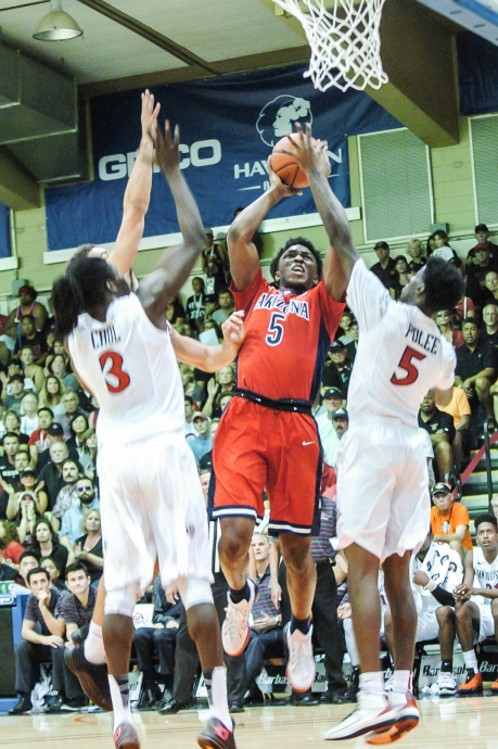 Tournament MVP Stanley Johnson challenges San Diego State's Dawyne Polee II and Angelo Chol in Wednesdays EA Sports Maui Invitational championship game at the Lahaina Civic Center. Joel B. Tamayo photo.