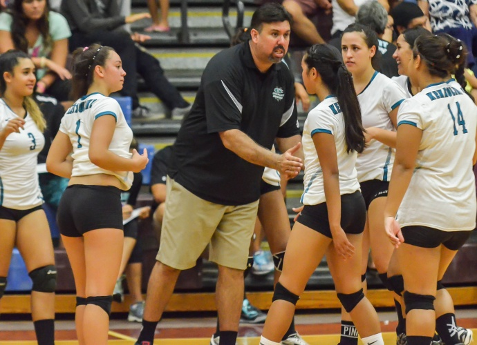 King Kekaulike head coach Al Paschoal with his team during a time out earlier this season at Baldwin High School. File photo by Rodney S. Yap.