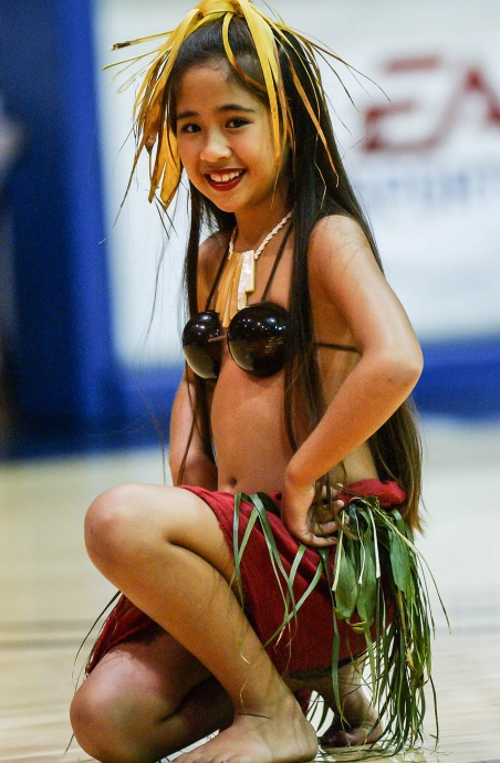The Old Lahaina Luau and Feast of Lele performers entertained during halftime of the Maui Invitational championship game Wednesday at the Lahaina Civic Center. Photo by Joel B. Tamayo.