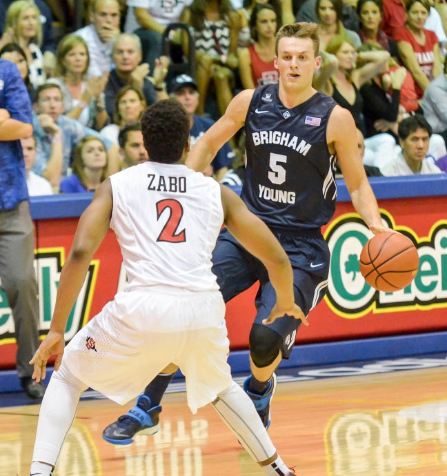 Kyle Collinsworth looks for a lane to the basket against San Diego State's Kevin Zabo during second-half action of Monday Maui Invitational Tournament at Lahaina Civic Center. Photo by Rodney S. Yap.