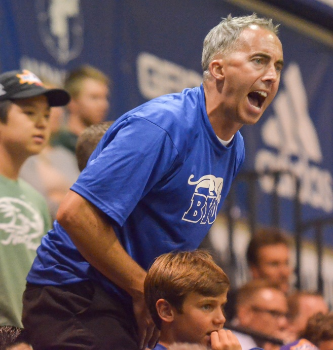A BYU fan lets the officials know how he feels about a call against his Cougars Monday during first-round action of the Maui Invitational Tournament at Lahaina Civic Center. Photo by Rodney S. Yap.
