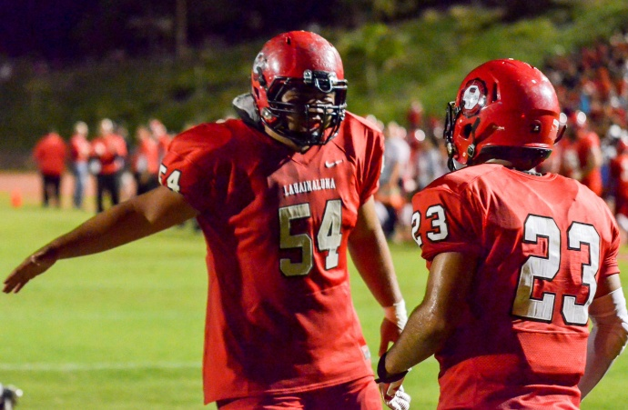 Lahainaluna co-captains Connor Mowat (54) and Jared Rocha-Islas (23) share in a touchdown moment Saturday. It was one of Rocha-Islas' three touchdown runs with Mowat leading the way. Photo by Rodney S. Yap.