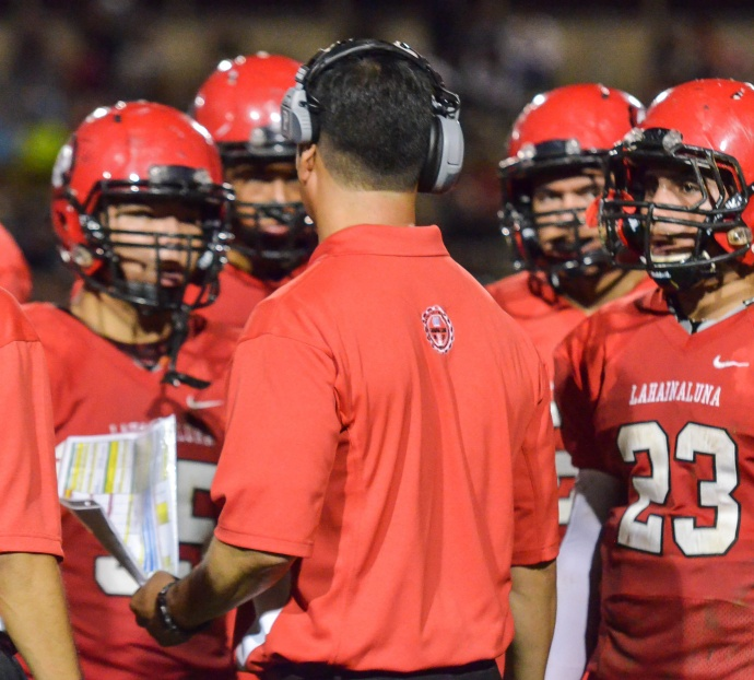Lahainaluna co-head coach Garret Tihada talks to his offense during a timeout last week against Kamehameha Hawaii. Photo by Rodney S. Yap.