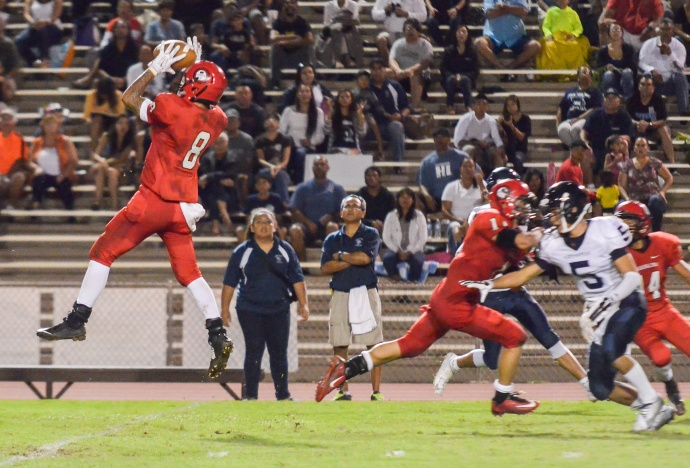 Lahainaluna safety Makoa Sione Filikitonga-Lukela (8) goes up high to pick off this pass, which he returned 66 yards for a touchdown Saturday. Photo by Rodney S. Yap.