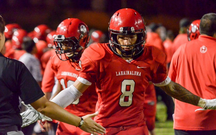 Lahainaluna safety Makoa Sione Filikitonga-Lukela (8) is congratulated on the Lunas' sidelines after returning an interception for a 66-yard touchdown Saturday. Photo by Rodney S. Yap.