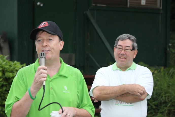 "Mike O'Dwyer, owner of Mulligans on the Blue, and Reb. Msgr. Terrence A.M. Watanabe, Executive Director of Hale Kau Kau, wish the players ""the luck of Irish"". Courtesy file photo."