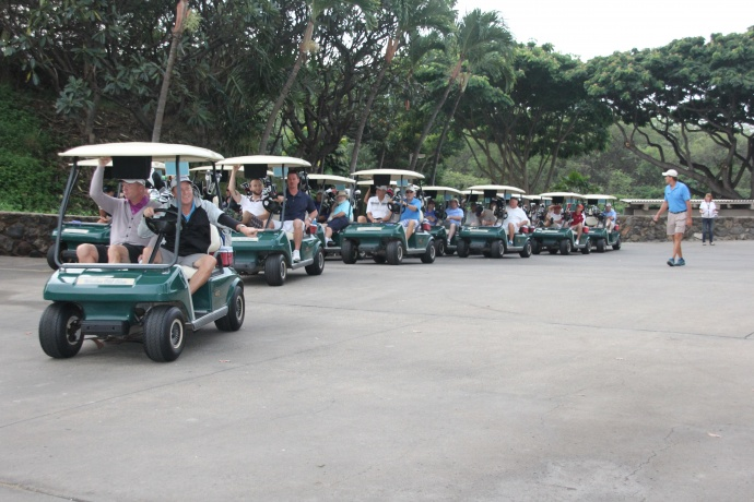 "The whole field of players heads out to their ""shot gun"" start positions for the 11th Annual Mulligans on the Blue Charity Golf Tournament to Benefit Hale Kau Kau."