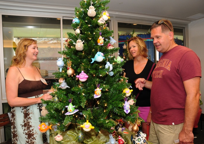 """Jennifer Lawrence of Jennifer's Gourds helps Andy and Sherry Wright of Mechanicsville, Va., select whimsical Christmas ornaments hand-painted by Lawrence. """"This gives me an opportunity to meet the public,"""" Lawrence said at the first-ever Made In Maui County Festival."""