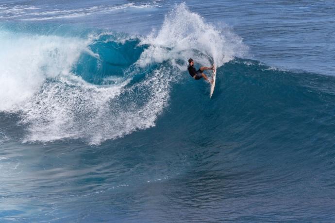 Kai Barger surfing Jaws - Image: Davin Phelps