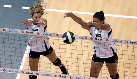 Molokai's Kalei Aldolpho (right) will be one of two seniors honored Saturday, following the Rainbow Wahine volleyball finale against UC Davis at 8 p.m. Photo by UH Athletics.
