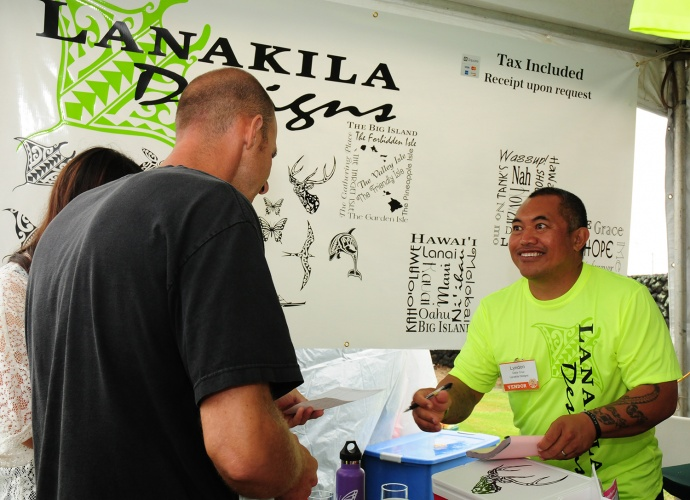 Molokai graphic artist Lyndon Dela Cruz of Lanakila Designs meets with a customer looking for customized artwork. Dela Cruz said he's glad he came to Maui where he's received a boost in confidence in himself and his business.