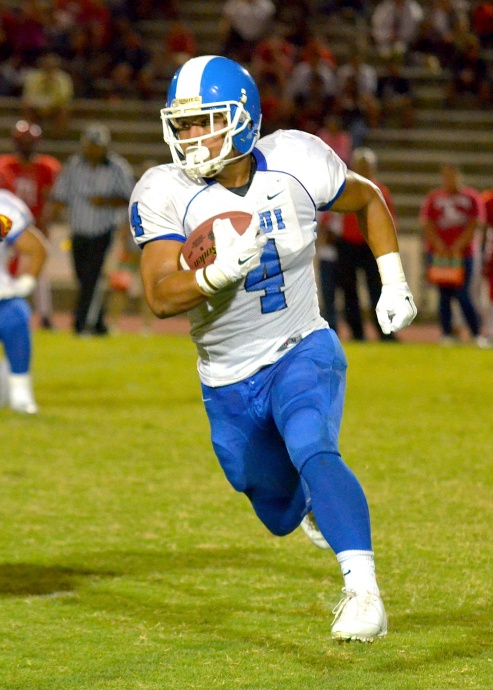Maui High running back Onosai Emelio will be busy playing two ways today at Aloha Stadium. File photo by Rodney S. Yap.