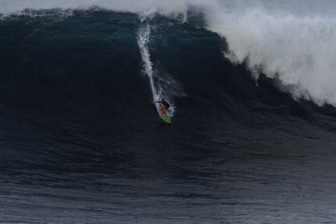 Paige Alms surfing Jaws - Image: Davin Phelps