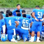 Maui High head coach David Bui talks with his team prior to its first-round contest at against Baldwin earlier this year at War Memorial Stadium. File photo by Rodney S. Yap.