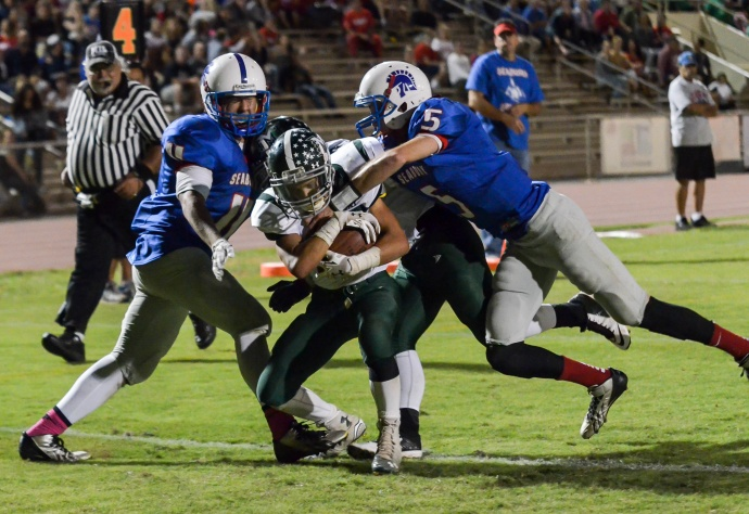 Molokai's Alden Abafo scores on this 7-yard run with two seconds left in the second quarter. Photo by Rodney S, Yap.