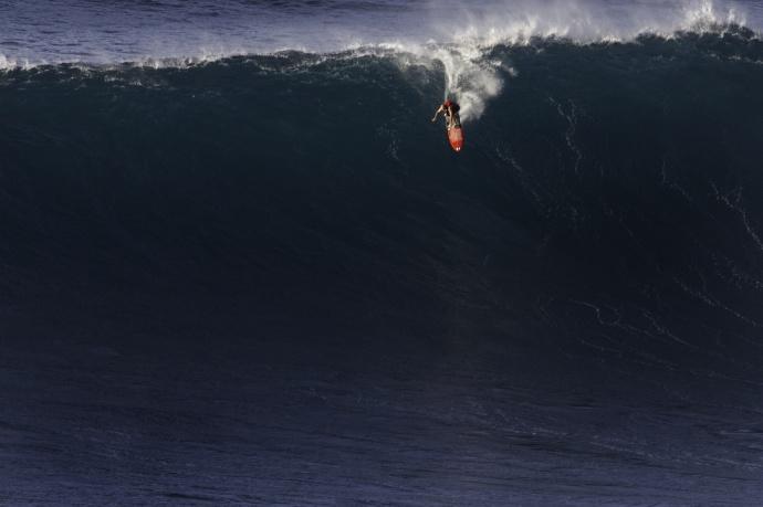 Shane Dorian surfing Jaws - Image: Davin Phelps