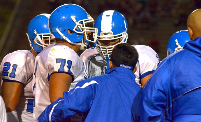 The Vainikolo's in the Saber defensive huddle with head coach David Bui. Photo by Rodney S. Yap.