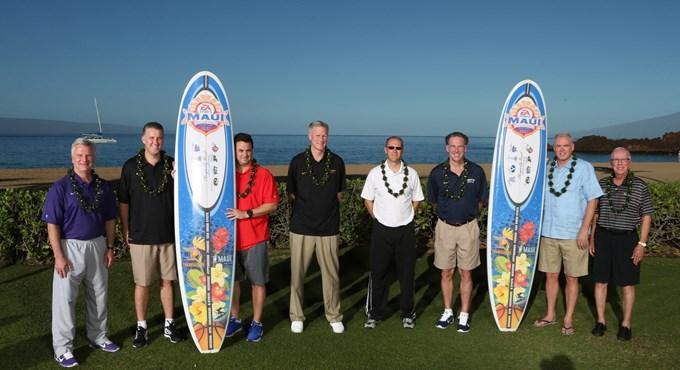 The coaches of the 2014 EA Sports Maui Invitational pose with surfboards Sunday at a press conference near the beach of the Sheraton Maui Resort in Lahaina. Photo courtesy of the EA Sports Maui Invitational.
