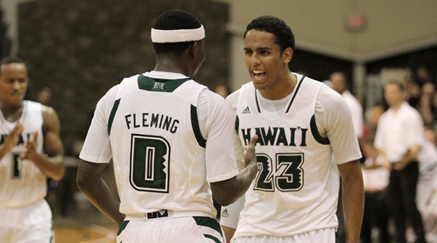 Hawai'i's Isaac Fleming (0) shares a moment with teammate Aaron Valdes (23) at War Memorial Gym on Friday. The 'Bows upset Pittsburgh, 74-70. Photo courtesy of UH Athletics.